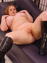 Plump blonde playing with her...